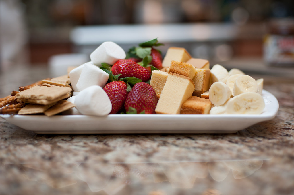 Description of . Graham crackers, marshmallows, strawberries, pound cake, pretzels and bananas are shown as ideas for dipping in fondue. (Sun photo by Holly Mahaffey/@hollymahaffey)