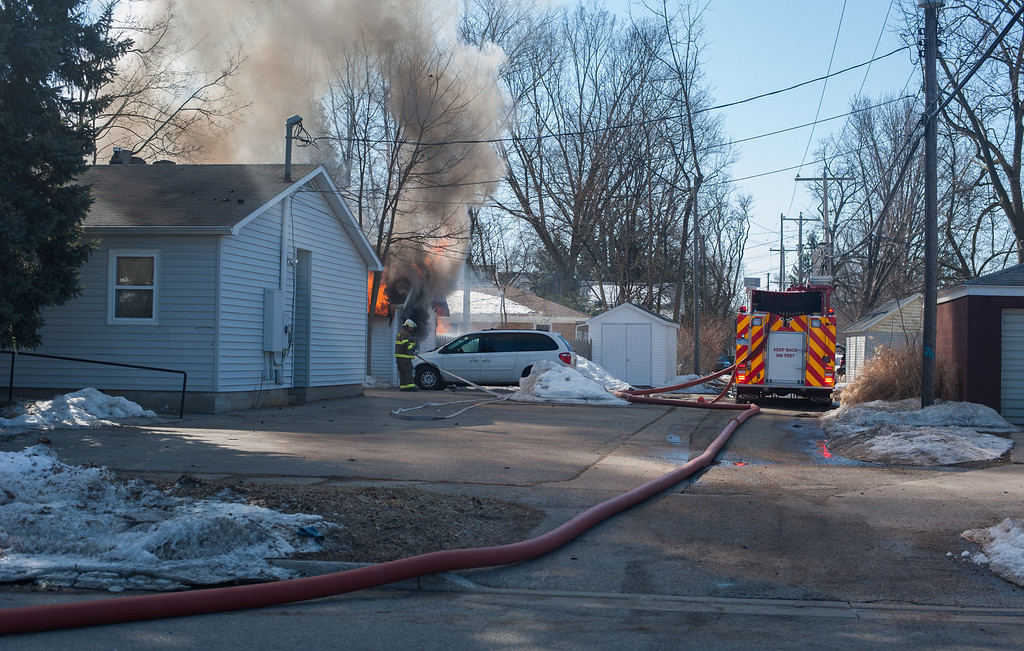 Description of . Smoke fills the downtown area while firefighters battle a blaze in a garage on University in downtown Mount Pleasant. (Sun photo Holly Mahaffey/@hollymahaffey)