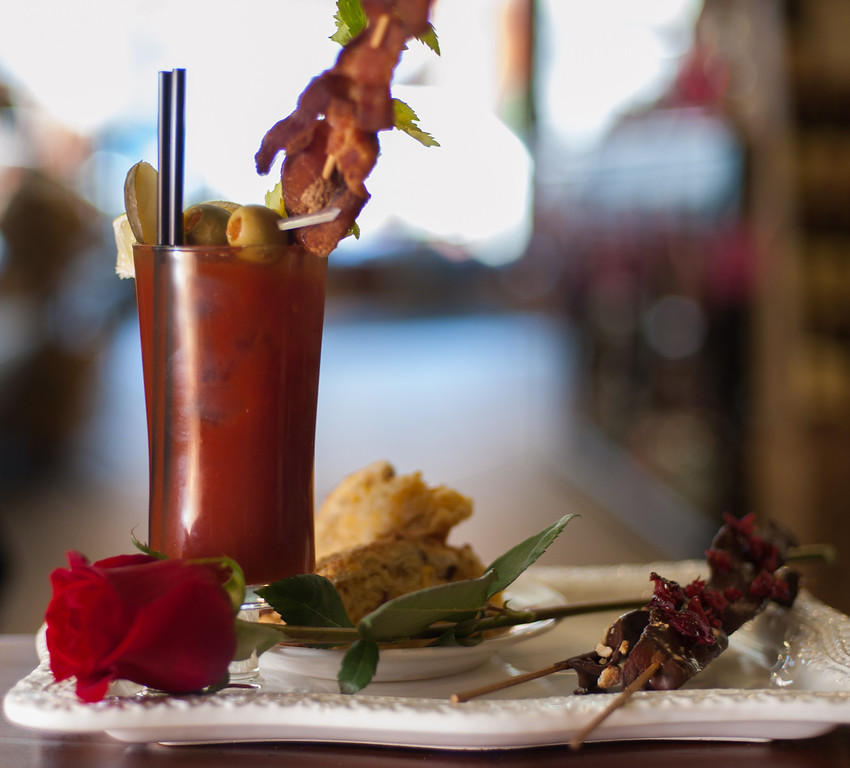 Description of . A Bloody Mary with bacon vodka is shown with chocolate-covered bacon and bacon cheddar & chive scones at the Market on Main in downtown Mt. Pleasant, Mich. (Sun photo by Holly Mahaffey/@hollymahaffey)