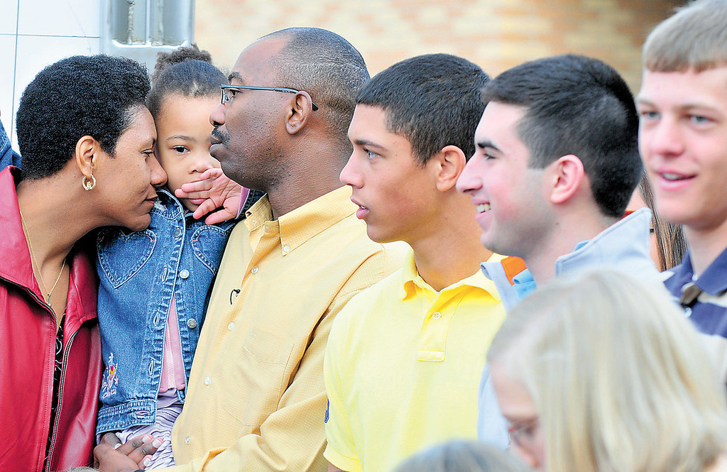 Description of . Keisha Brown nuzzles against her daughter Angel's cheek, with her husband, Damon, and members of the Sacred Heart boys basketball team outside of the school on April 27, 2009 on the day Good Morning America visited Brown.