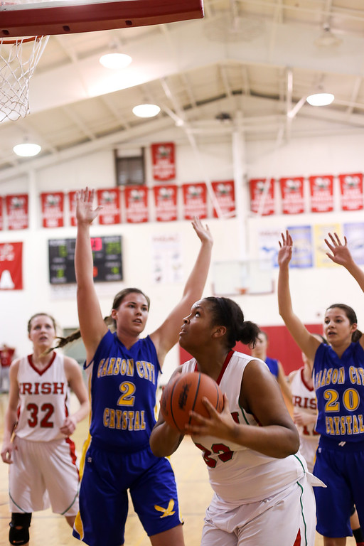 Description of . Sacred Heart sophomore Averi Gamble, (33) rebounds a shot and looks to the hoop as Carson City-Crystal plays aggressive defense at Sacred Heart Thursday, Jan. 23, 2014. Carson City-Crystal won 50-23.  (Sun photo by KEN KADWELL/@KenKadwell).