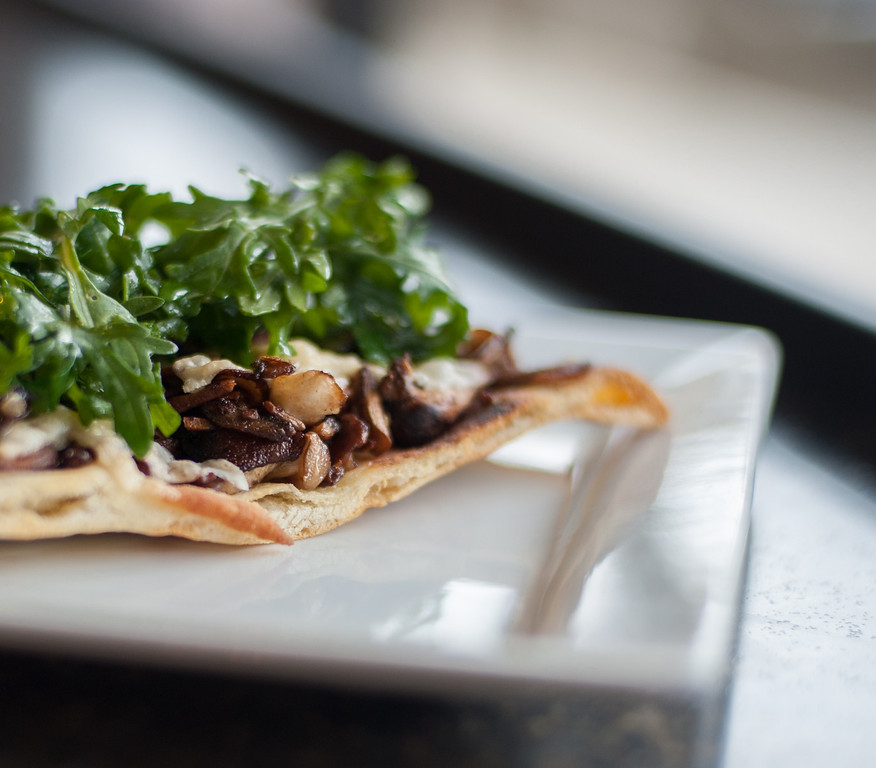 Description of . Mushroom & parmesan flatbread is shown at the Market on Main in downtown Mt. Pleasant. Chef Emma Currie of the Brass Cafe shares her tips for using and preparing mushrooms. (Sun photos by Holly Mahaffey/@hollymahaffey)