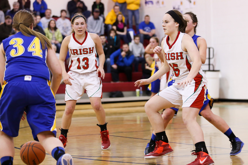 Description of . Sacred Heart's Bainy Scully, (15) and Riley Terwilliger, (13) try to stop Carson City-Crystal's Mackenzie Geister, (34) from advancing up court at Sacred Heart Thursday, Jan. 23, 2014. Carson City-Crystal won 50-23.  (Sun photo by KEN KADWELL/@KenKadwell).