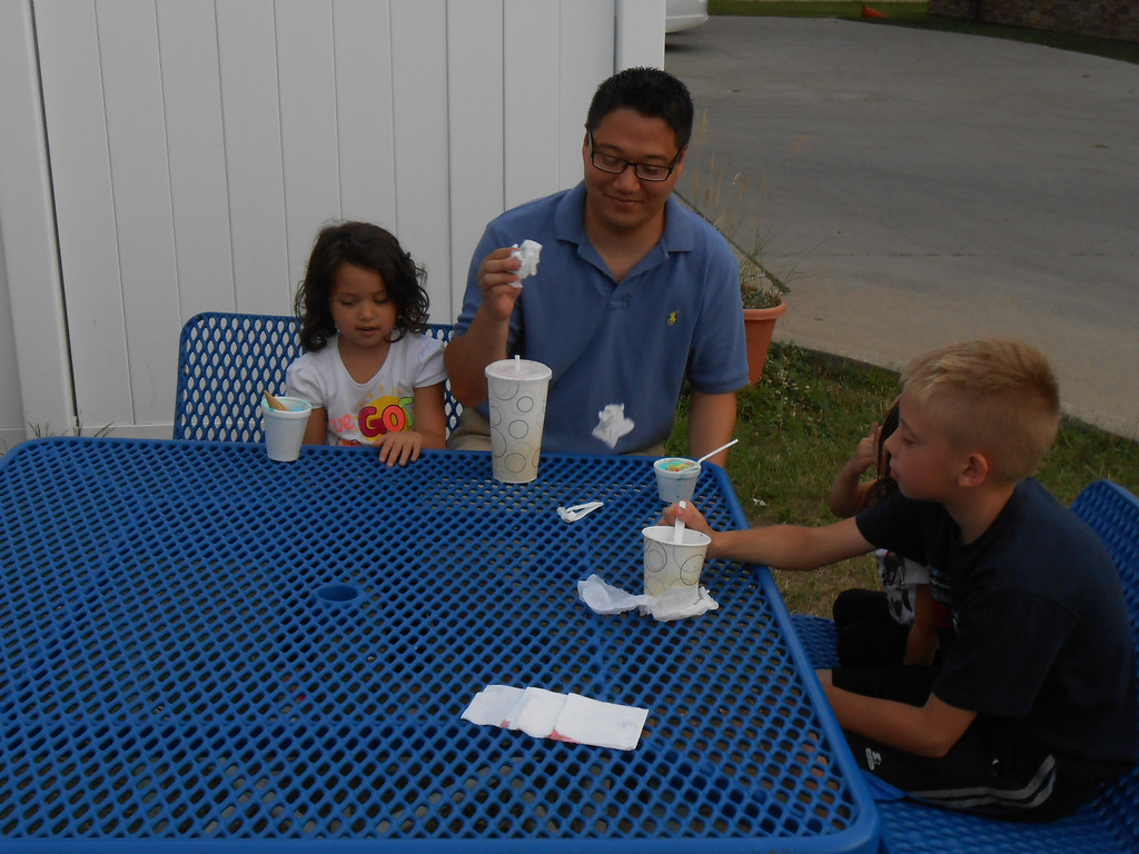 Description of . Residents enjoy ice cream at Doozie's Ice Cream Place on Sunday June 22, 2014 . Photos by Kelly Rocheleau.