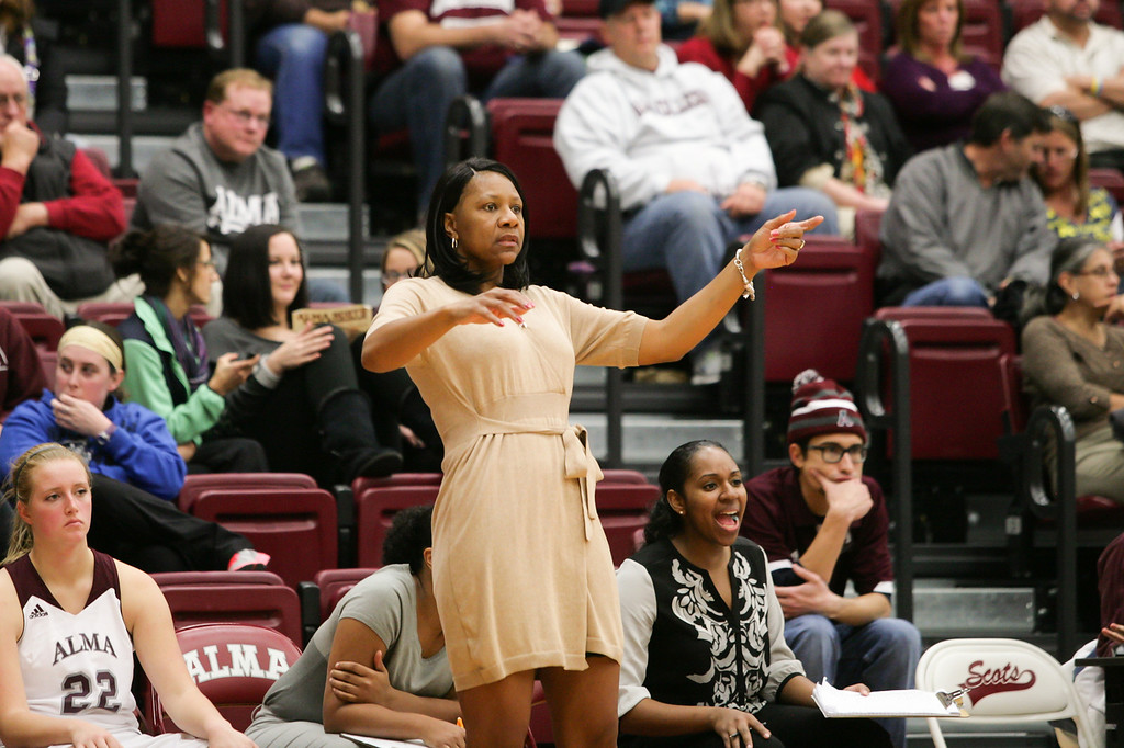 Description of . Special to the Sun - Ken Kadwell/@KenKadwell Alma College women's basketball coach Keisha Brown stands as she watches her team play against Defiance College at Alma Wednesday, Nov. 20, 2013.