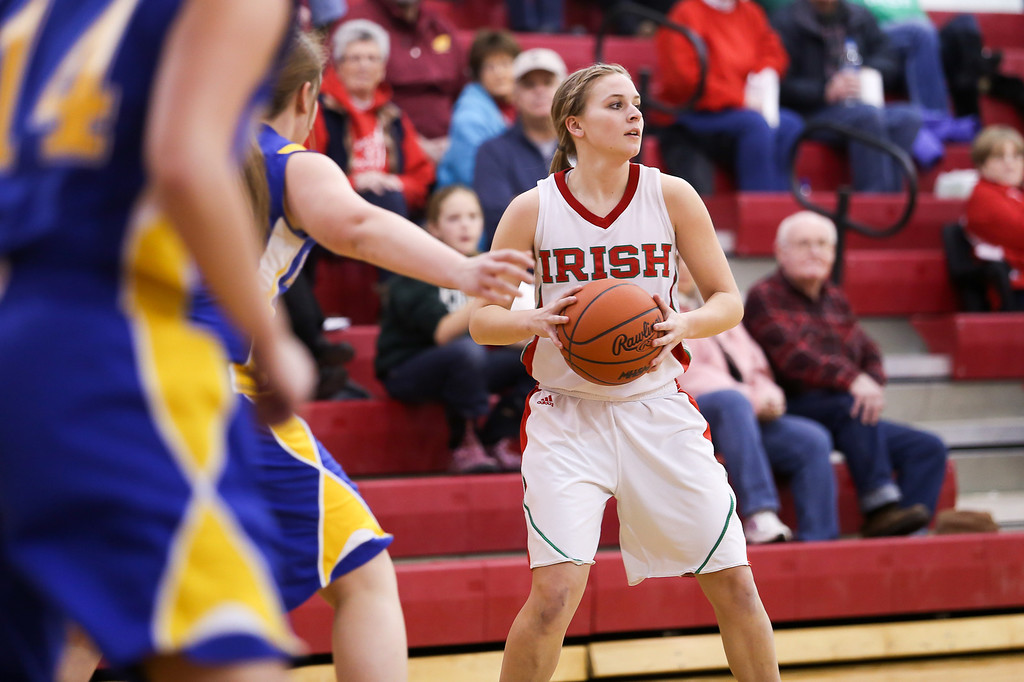 Description of . Sacred Heart senior Sara Hansen, (2) looks for an open teammate to pass the ball to as Carson City-Crystal plays aggressive defense at Sacred Heart Thursday, Jan. 23, 2014. Carson City-Crystal won 50-23.  (Sun photo by KEN KADWELL/@KenKadwell).