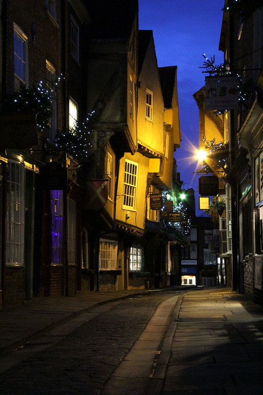 Description of . The Shambles with its 14th century timber-framed buildings gets its name from the butcher stalls that once lined this old street (Photograph by Dennis Lennox)