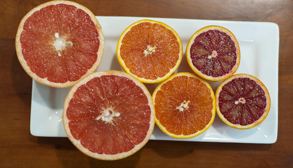 Description of . Blood oranges, Cara Cara oranges and pink grapefruit are shown at the Market on Main in downtown Mt. Pleasant. (Sun photo by Holly Mahaffey/@hollymahaffey)