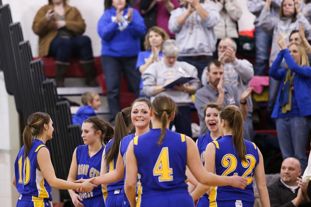 Description of . Carson City-Crystal senior Tori Christiansen, (14) smiles as her team celebrates a victory against Sacred Heart Thursday, Jan. 23, 2014. Carson City-Crystal won 50-23.  (Sun photo by KEN KADWELL/@KenKadwell).