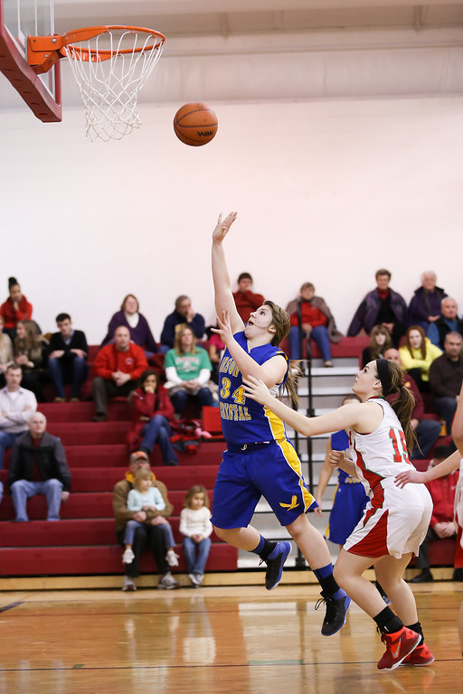 . Carson City-Crystal senior Mackenzie Geister, (34) goes up for two after spinning off a defender at Sacred Heart Thursday, Jan. 23, 2014. Carson City-Crystal won 50-23.  (Sun photo by KEN KADWELL/@KenKadwell).