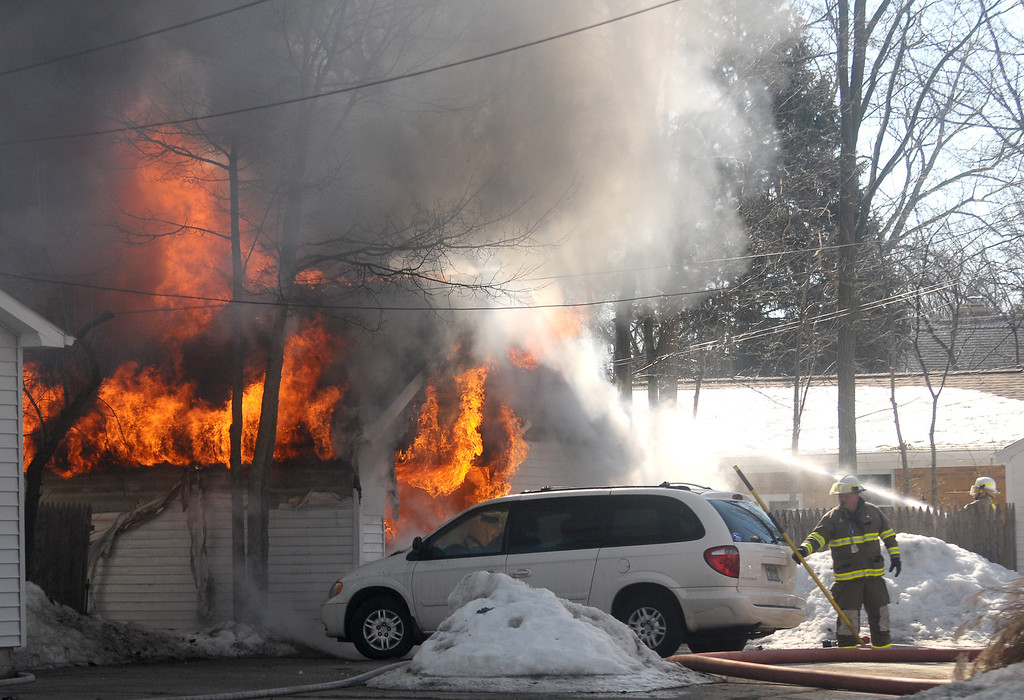 . Firefighters battle a blaze in a garage on University in downtown Mount Pleasant. (Sun photo by LISA YANICK-JONAITIS)