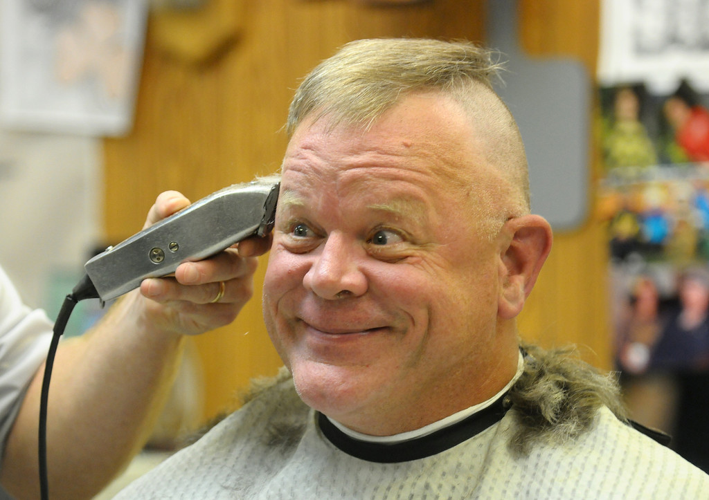 . Chip Manne smiles at his watching family as his head is shaved at the Broadway Barbershop in Mt. Pleasant on Friday, Oct. 11, 2013. Manne was one of many who shaved their heads in a showing of support for Manne\'s grandson Drew Clarke who is undergoing chemotherapy for cancerous tumor near his spine. (sun photo by LISA YANICK-JONAITIS/@lisayj_msun)