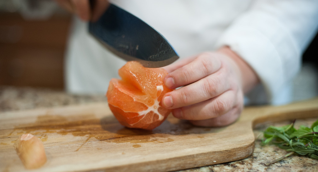 . Emma Currie segment grapefruit by cutting between the membranes and removing the pieces carefully intact. (Sun photo by Holly Mahaffey/@hollymahaffey)