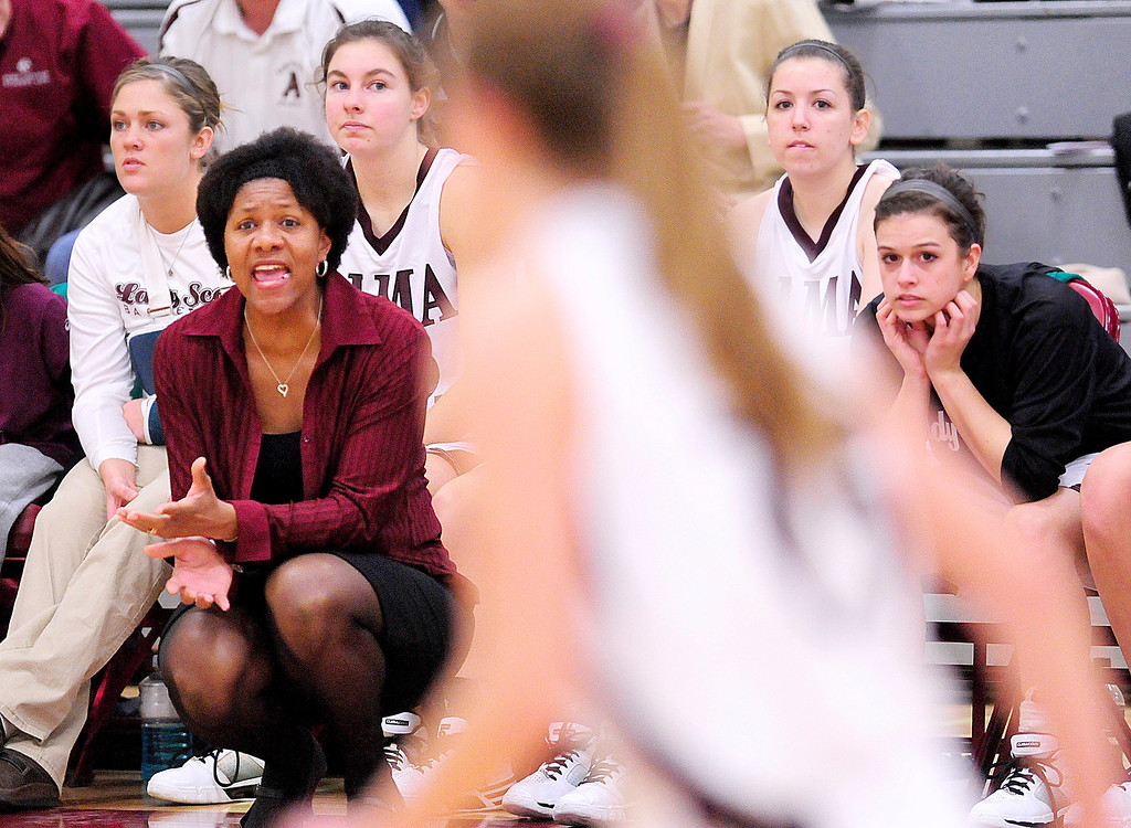 . Alma women\'s basketball head coach Keisha Brown calls out to her players during the first half of the home opener against Aquinas College on Tuesday.