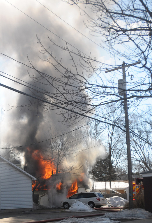 . Firefighters battle a blaze in a garage on University in downtown Mount Pleasant.(Sun photo by LISA YANICK-JONAITIS)