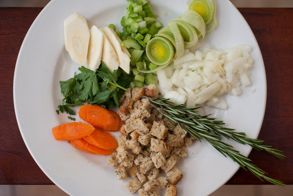 """. The basic ingredients for Thanksgiving stuffing are shown. Emma Currie said, \""""If you want to experiment with the stuffing you can break the categories into three groups: first, the basics such as celery, onion, garlic, carrot; then the binders such as stock, cream or eggs; and then the add-ons like nuts, dried fruit, herbs and spices.\"""" (Sun photo by Holly Mahaffey/@hollymahaffey)"""