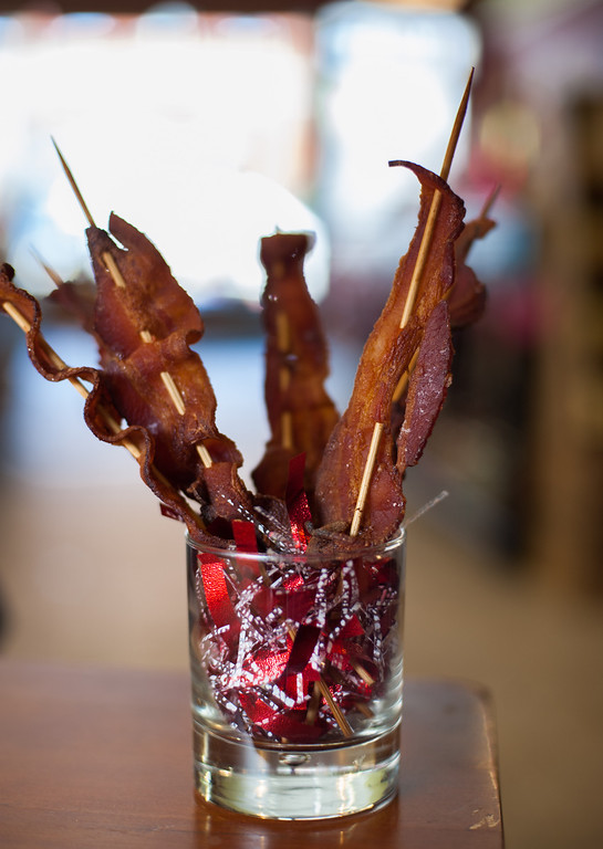 """. Emma Currie\'s \""""bacon bouquet\"""" is shown before being dipped in chocolate at the Market on Main on Tuesday, Feb. 11, 2014. (Sun photo by Holly Mahaffey/@hollymahaffey)"""