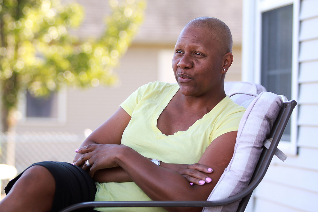 . Alma College women\'s basketball coach Keisha Brown who has beaten breast cancer for the third time sits outside her home in Mount Pleasant Monday, Sept. 10, 2012.  (Sun photo by KEN KADWELL/@KenKadwell)